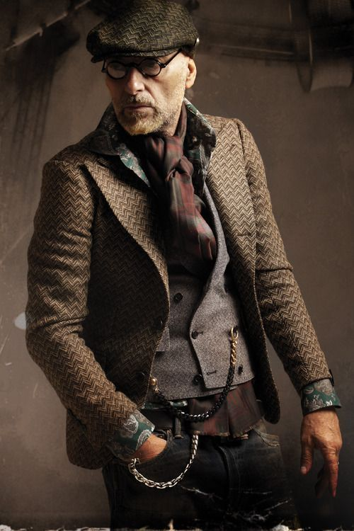 Rock a dark brown herringbone blazer with black jeans to look classy but not particularly formal. Shop this look for $132: http://lookastic.com/men/looks/flat-cap-jeans-longsleeve-shirt-waistcoat-blazer-scarf/4207 — Dark Brown Herringbone Flat Cap — Black Jeans — Dark Green Floral Longsleeve Shirt — Grey Waistcoat — Dark Brown Herringbone Blazer — Burgundy Plaid Cotton Scarf