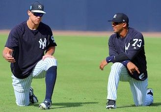 Seattle Seahawks quarterback Russell Wilson (right) talks with Yankees outfielder Aaron Judge before Monday's spring training game in Tampa. (Butch Dill | USA TODAY Sports)