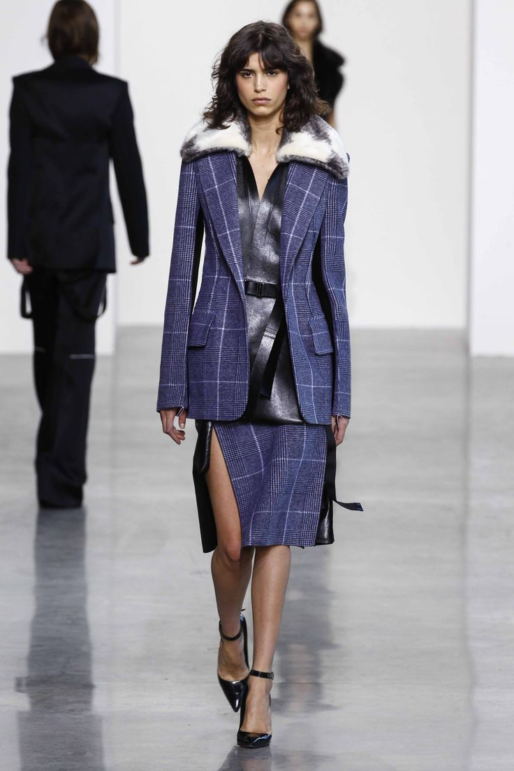 A Prince of Wales patterned wool + leather jacket with matching pleated skirt from the Fall 2016 Calvin Klein Collection. #nyfw
