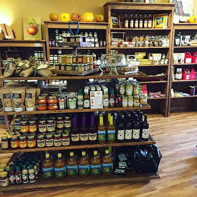 A beautiful store display at New Ground Market in Ellijay, GA featuring our island gondolas and staggered book shelf displays. Email us for a custom quote for your store! #island #islandgondola #gondola #shelves #shelfdisplay #bookshelfdisplay #rusticbookshelf #bookshelf #rustic #rusticretail #merchandiser #store #storefront #newgroundmarket #ellijay #wood #woodpackaging #wooddisplay #display #custom
