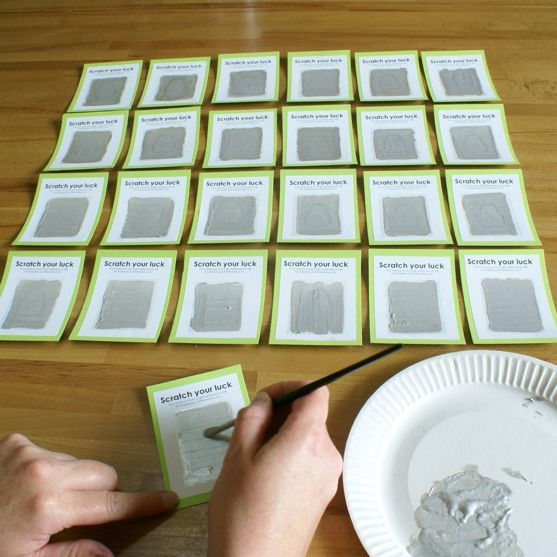 DIY scratch-off cards  1. Place a piece of sticky back plastic (Contact Paper) and put it on the design.  2. Mix metallic acrylic paint with washing liquid (liquid dish soap?). Try 1 part washing liquid and 2 parts paint.  3. Paint 1 example -  let dry & test. Paint 2 coats if needed.