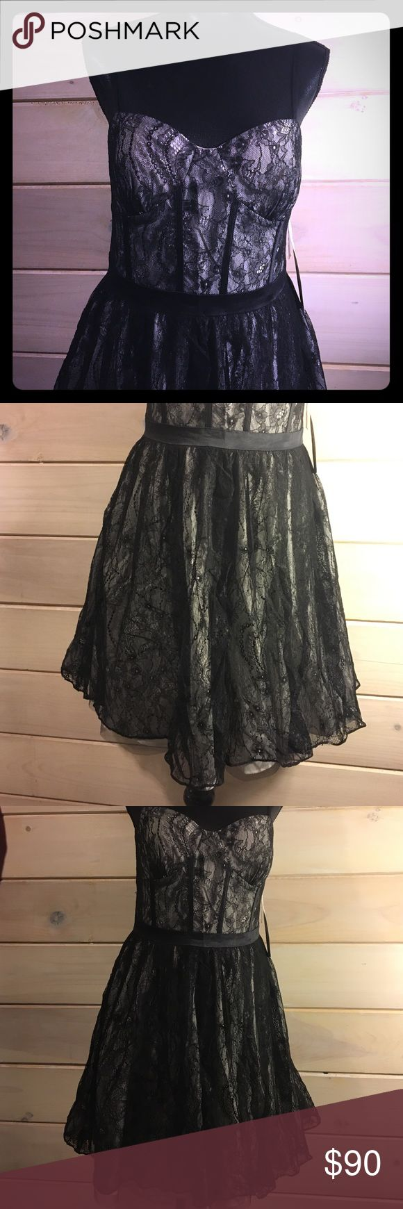 NWT Aidan Mattox Black Lace Cocktail Dress Sz 10 Brand NEW Aidan Mattox Lace Prom / Cocktail Dress👗  Absolutely Adorable!!! 👗Corset style top w/spaghetti straps 👗Satin details around the waist & bust 👗A-line 3 layer skirt 👗Mid length  👗Black lace over cream satin 👗Please feel free to ask questions...(26) Aidan Mattox Dresses Midi