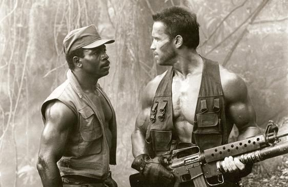 Arnold Schwarzenegger and Carl Weathers in a classic image from Predator @Arnold Dela Cruz Schwarzenegger