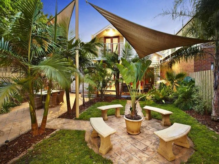 photo of a tropical garden design using pavers with outdoor dining shade sail gardens photo browse hundreds of images of tropical gardens photos of