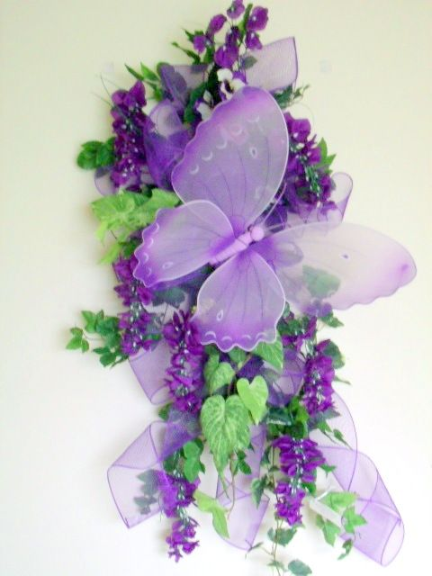 Purple butterfly door swag welcomes spring.