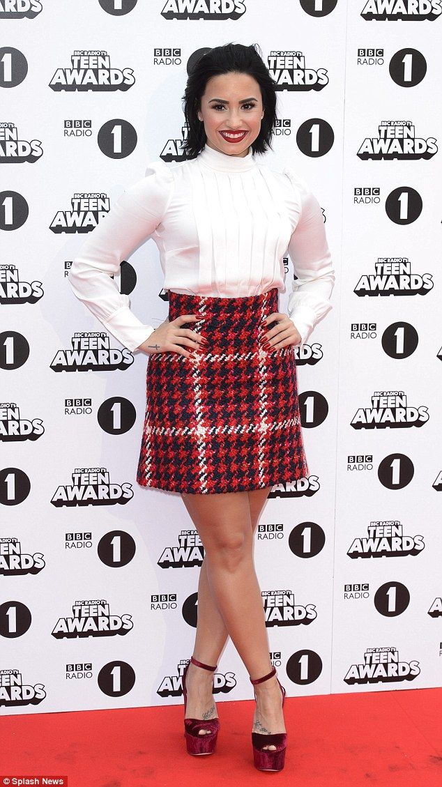 Schoolgirl chic: Demi Lovato was top of the class in a houndstooth miniskirt and a smart white blouse