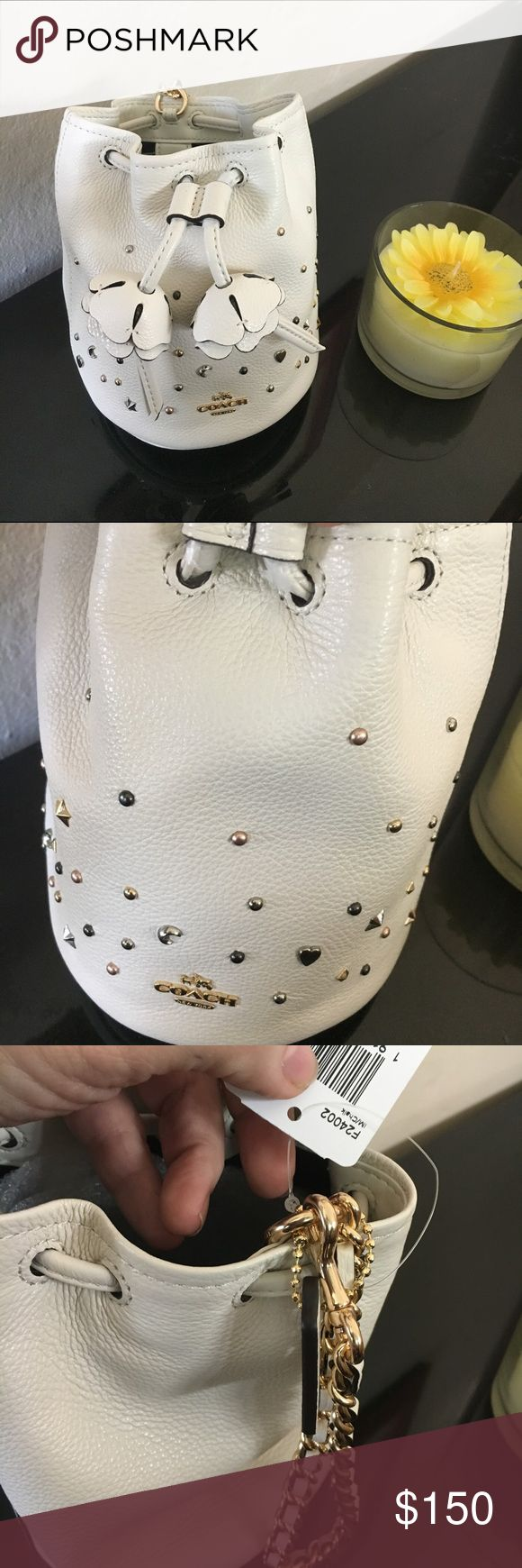 Stardust Studs Petal Wristlet Coach Absolutely adorable petal Wristlet from Coach. Matches with the stardust Accordion Wallet that is listed in my closet. Beautiful and perfect for a gift! Coach Bags Clutches & Wristlets