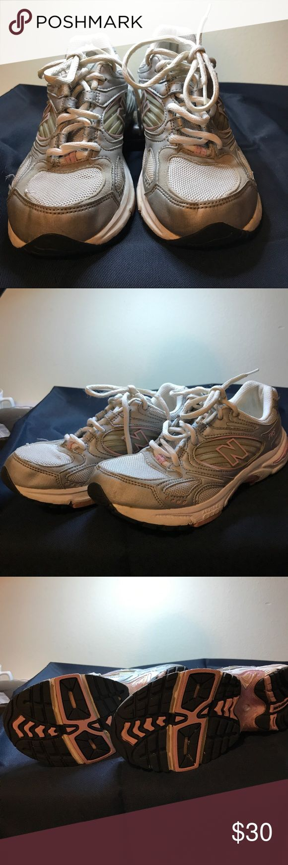 Nike ladies running shoe, size 7 1/2 Nike ladies running shoe, size 7 1/2 , preowned but in excellent condition gray with pink trim.  Proceeds from this closet support Project Hope,a ministry to homeless single moms and their children Nike Shoes Sneakers