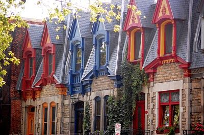 Vivid hues and classic brickwork in Montreal, Quebec, Canada. #Canada #travel #cities