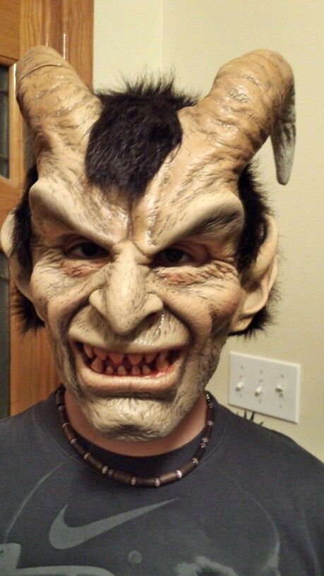 scary halloween mask of elegant devil the horns with the blood stained teeth will make