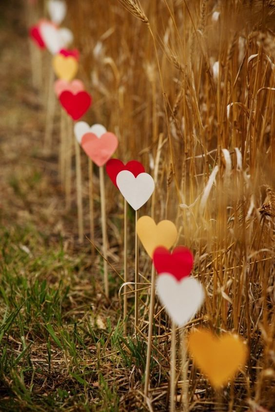 Hearts on Sticks for an Outdoor Event - 17 Homemade Wedding Decorations for Couples on a Budget - EverAfterGuide