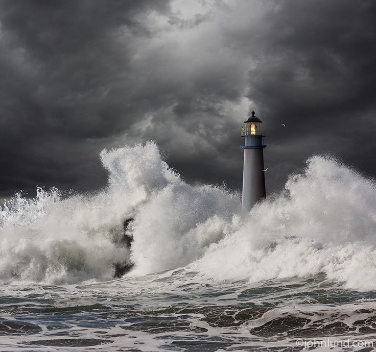 A Keeper Stands Watch Atop This Lighthouse In A Raging