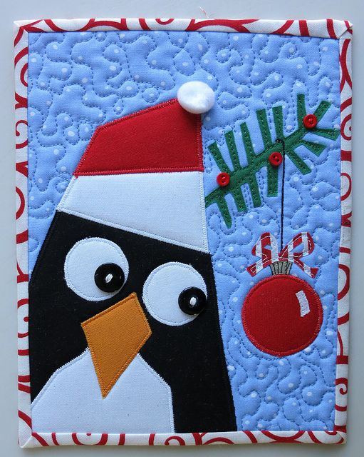 a penguin holiday mug rug