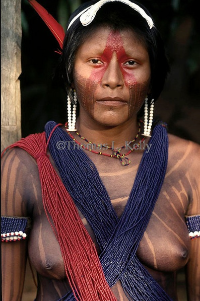 Brazil | A painted and bedecked Kayapo woman. Body paint, besides being applied as sexual ornamentation, is also used as a topical treatment. Gorotire Kayapo Reserve. Amazon | © Thomas Kelly