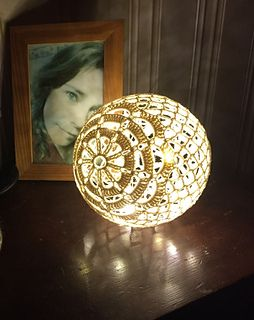 This pattern includes instructions for 2 different crochet light balls. The flower ball and one simpler version that I call the net ball.