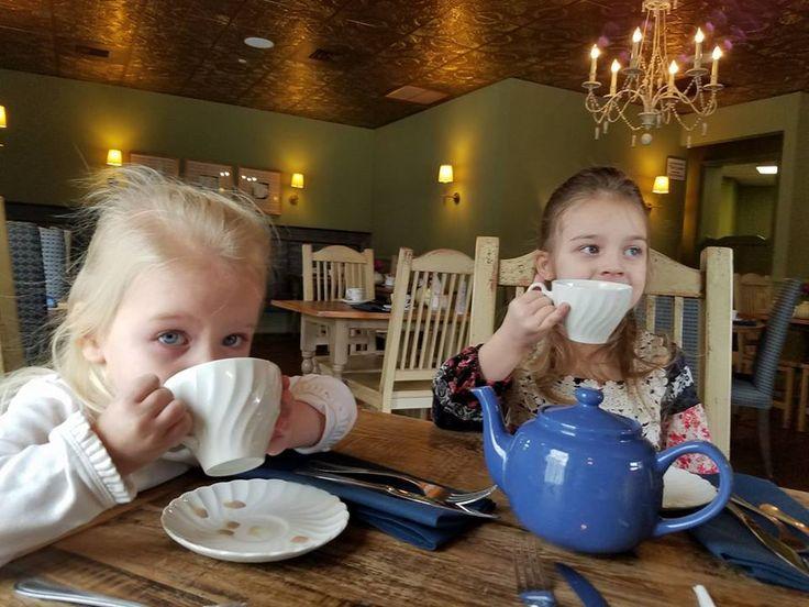 Little cuties enjoying their tea party!