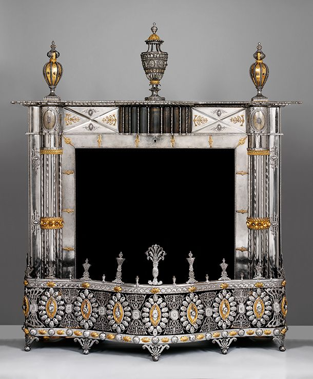 Fireplace with perfume burner  and urns, made at the Russian Imperial Arms Factory, about 1800, Russia  (Tula), burnished steel with applied decoration in gilded copper alloy. l Victoria and Albert Museum