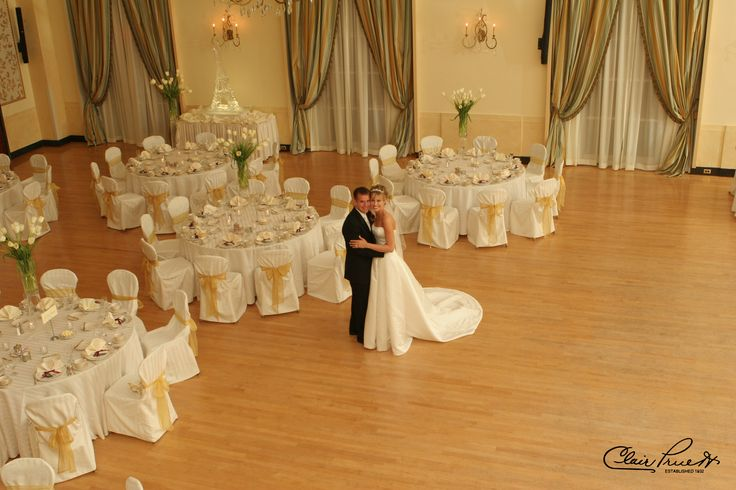 Flowing French tulip centerpieces create an alluring drama in the ballroom at DuPont Country Club.