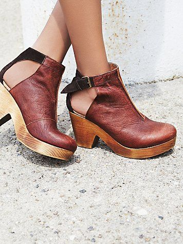 Amber Orchard Clog | Spanish crafted round-toe clog boots with side cutouts and an adjustable ankle strap with buckle closure. Wooden heels with rubber soles.  *By Free People  *Artisan crafted from fine leathers and premium materials, FP Collection shoes are coveted for their signature vintage aesthetic.