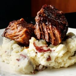 Slow Baked Boneless Beef Short Ribs perfect for a lazy Sunday dinner. Melt in your mouth short ribs served over perfect mashed potatoes.