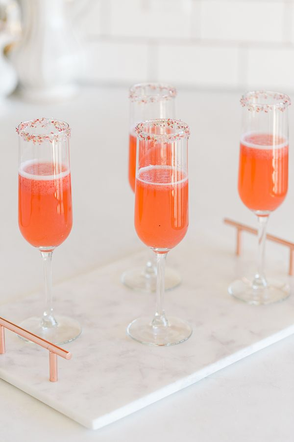 A Beautiful Strawberry Rosé Champagne Cocktail Recipe    Ingredients:  1 cup puréed strawberries, rosé champagne, sprinkles of your choice.