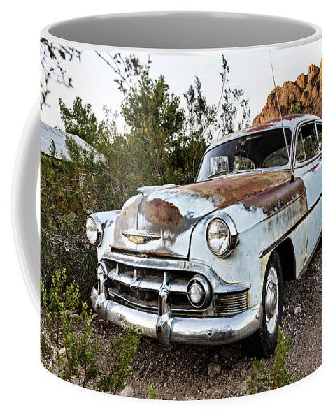 Coffee Mug featuring the photograph Still In Style by Evgeniya Lystsova. Old rusty truck in Nelson Ghost town, Nevada, USA. Coffee time, Kitchen, Gift, Home and Office products. Our ceramic coffee mugs are available in two sizes: 11 oz. and 15 oz. Each mug is dishwasher and microwave safe. SHIPS WITHIN 1 -2 business days.