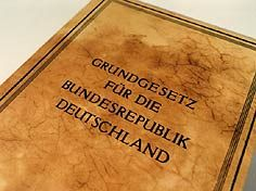 Government: The constitution in Germany is a big but important book. Anybody who works for the Government in Germany must follow the rules in it or they will lose their job.