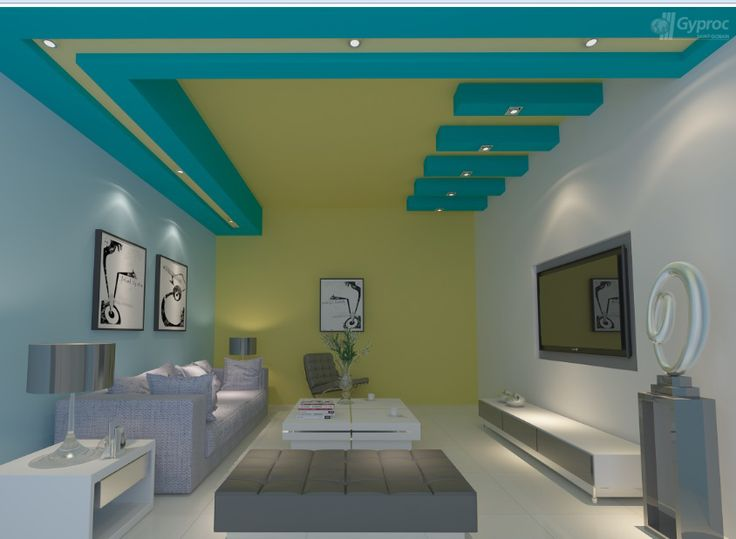 Very rarely done colored false ceiling. Nice concept with wall color continuation to main ceiling n contrast dark shade color for false ceiling. Great idea for bigger living rooms.
