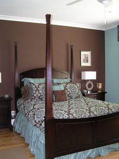 Light aqua bedroom with dark brown accent wall.