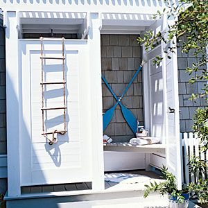 Ideas for…Fresh-Air Showers | Save Room - • Hang shatterproof mirrors to reflect light and visually expand the space without the danger of broken glass.  • Mount boat cleats or hooks to hold wet bathing suits, robes, and towels.  • Build a bench box for extra storage and seating   | CoastalLiving.com