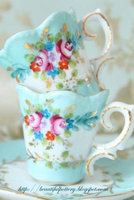 Vintage teacups.../- love them. I have a two sets I keep my rings and bracelets in when I'm going to bed.