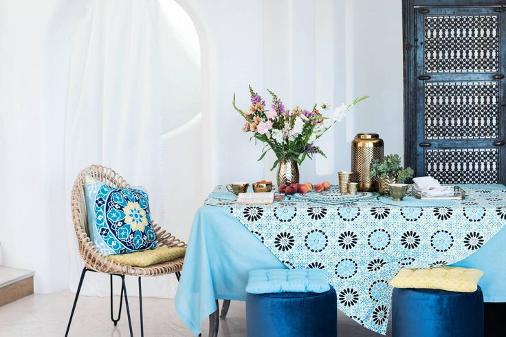 Mosaic patterns and a bright, Mediterranean colour palette create a winning interior with table cloths, cushions, rugs and blankets.