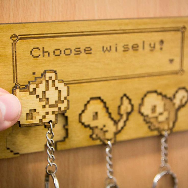 Choose wisely! Always thetoughest decision in every Pokemon game. These pixelated starter Pokemon sprite keyrings come a mountable backing that's easy enough to hang on any wall. Never leave home without a Pokemon!