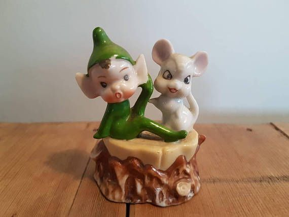 Check out this item in my Etsy shop https://www.etsy.com/au/listing/548555629/vintage-pixie-elf-and-mouse-on-a-log