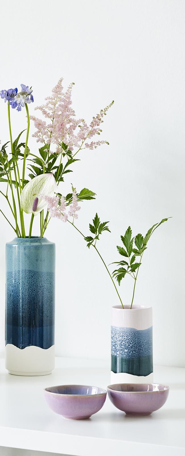 Let your blooms blossom in this artistic Isabela Tall Ceramic Vase.