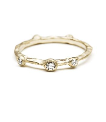 This is another contender for the ring! Textured Supernova Band << back to Stacking Rings Style#: T-R7 Textured stack band with scattering of five diamonds in a variety of sizes (0.10cttw)