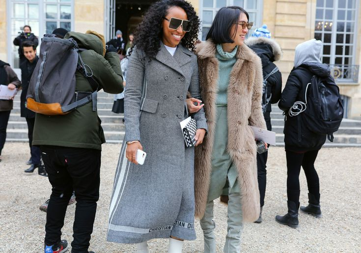 Shiona Turini in a Dior coat and Eva Chen in a Whistles top, Alejandra Alonso Rojas sweater and skirt and Oscar de la Renta shoes