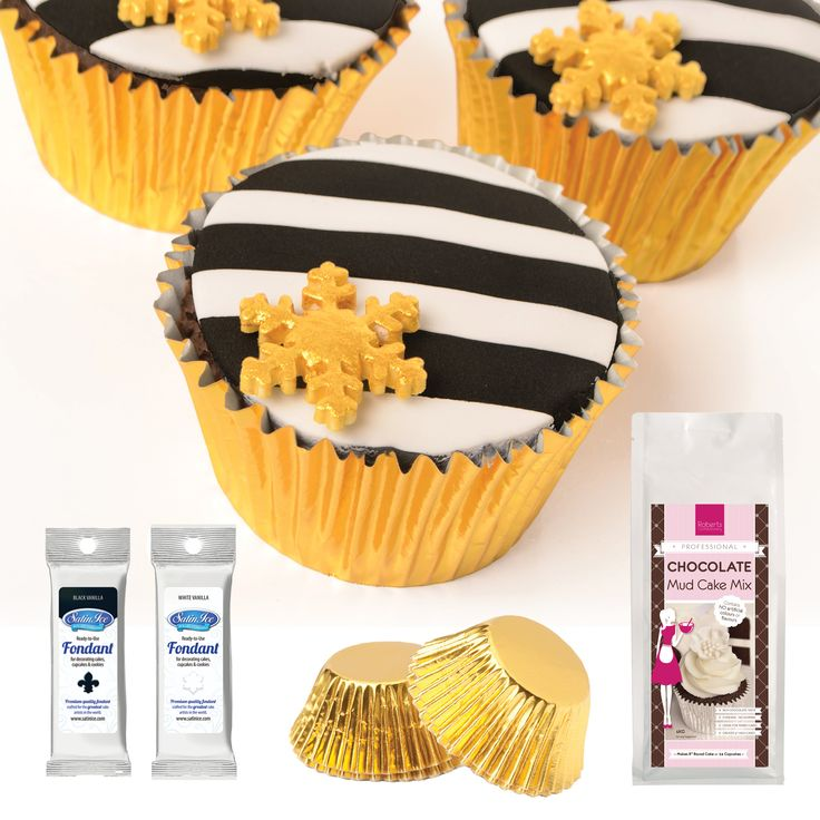 Monochrome cupcakes. Made with Black & White Satin Ice and Roberts Confectionery Cake Mix.