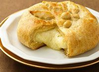 Baked Brie.  Elegant yet easy.   Wrap in crescent roll dough and bake.  I like blackberry preserves drizzled over it. I serve with crackers, apples and pears.