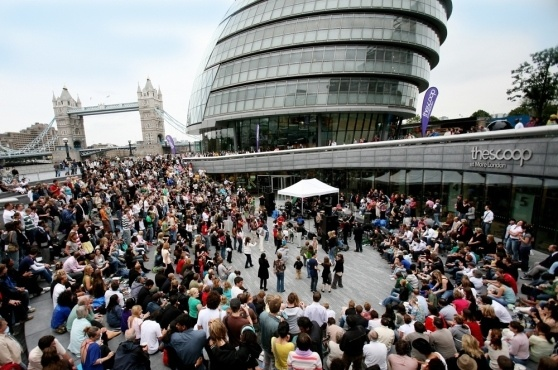 """""""The Scoop at More London is an outdoor sunken amphitheatre with seating for 800. Throughout the summer months it regularly hosts a variety of free events - from free films, free music and free theatre to local community events and activities. The Scoop at More London is open to everyone."""""""