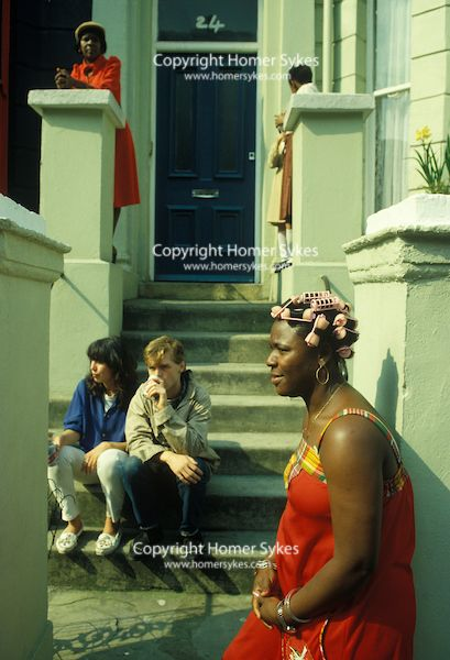 1970S ETHNIC HAIR DO STYLE ROLLERS CURLERS BLACK WOMAN LONDON Woman in pink curlers Notting hill Gate West London UK. 1970s