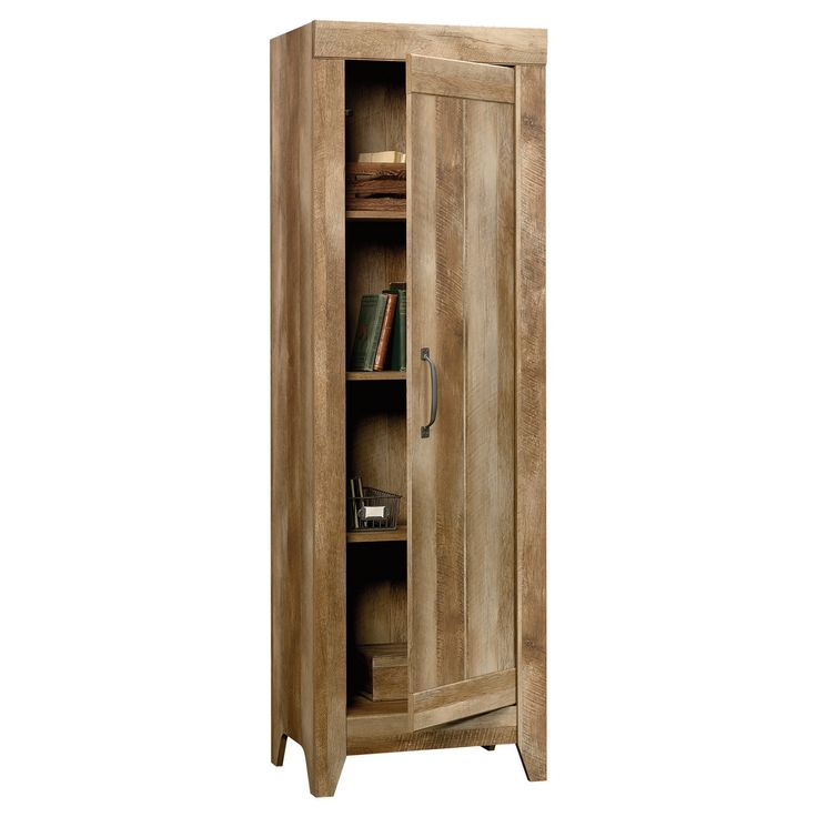 This narrow storage cabinet has three adjustable shelves hidden away behind the door, allowing items to be stored away while keeping the room neat and organized. This storage furniture conveniently fits in smaller rooms and features:Three adjustable shelves behind door.Door can be configured to open from the right or left.Craftsman Oak finish.
