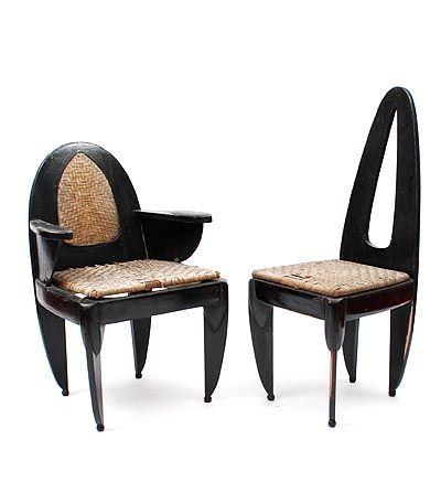 Eénmalig uitgevoerde Amsterdamse School eetkamerstoel en fauteuil 2x gekleurde houten stoelen met coromandel accenten en met gevlochten pitriet zittingen ontwerp W.M.Retera 1890 - 1955 uitvoering onbekend Nederland 1917