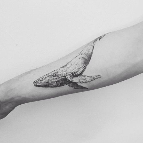 Illustrative whale tattoo on the right forearm. Tattoo artist:...                                                                                                                                                                                 More