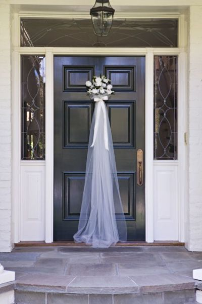 Front door greeting for a bridal shower that takes its inspiration from the bridal veil.  See more bridal shower decorations and party ideas at www.one-stop-party-ideas.com