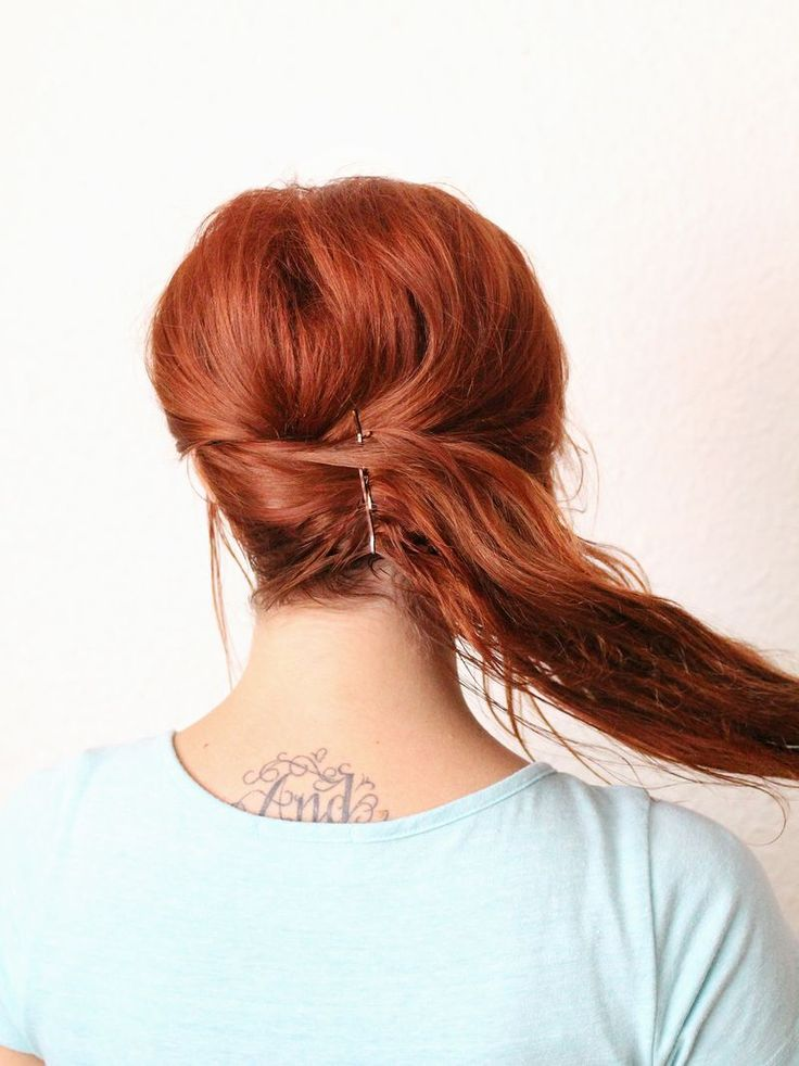 Step Three: Gather your hair to one side of your head and pin. You will be pinning over your first round of bobby pins, as shown above.