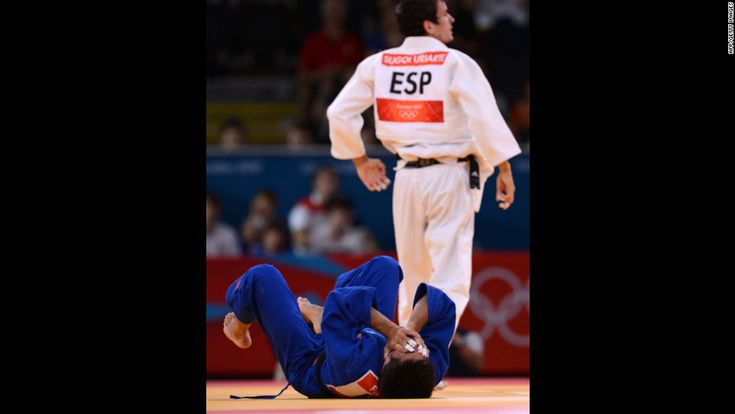 Francesco Faraldo of Italy, in blue, reacts after losing against Sugoi Uriarte of Spain, in white, during their men's judo event. http://www.PaulFDavis.com/success-speaker (info@PaulFDavis.com)