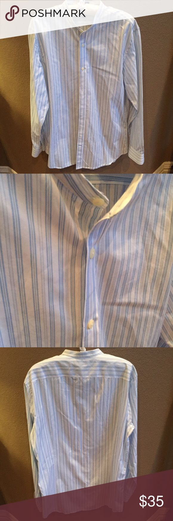 Banana Republic Grant Fit Banded Collar Shirt L Never worn like new condition Banana Republic Grant Fit Banded Collar Shirt in size Large. Banded collar. Clean front. Adjustable double-button barrel cuffs. Seams, armhole and collar are specially treated to stay smooth. Buttons are securely cross-stitched. Interlined collar has a crisper finish. Triangular gusset at side seams adds durability.  Item is from a pet and smoke free home.  P30 Banana Republic Shirts Dress Shirts