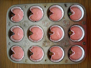 Don't want to buy shaped pans? Make heart-shaped (or pac man) cupcakes using marbles.
