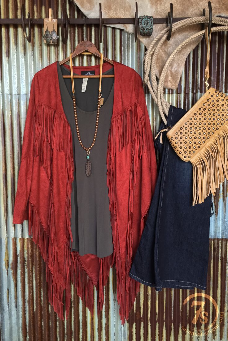 - Clay faux suede fringe jacket - Angled cut hemline front and back for a slimming effect - Southwest angled fringe design - Sleeves run shorter, for most best worn scrunched up for a 3/4 sleeve look